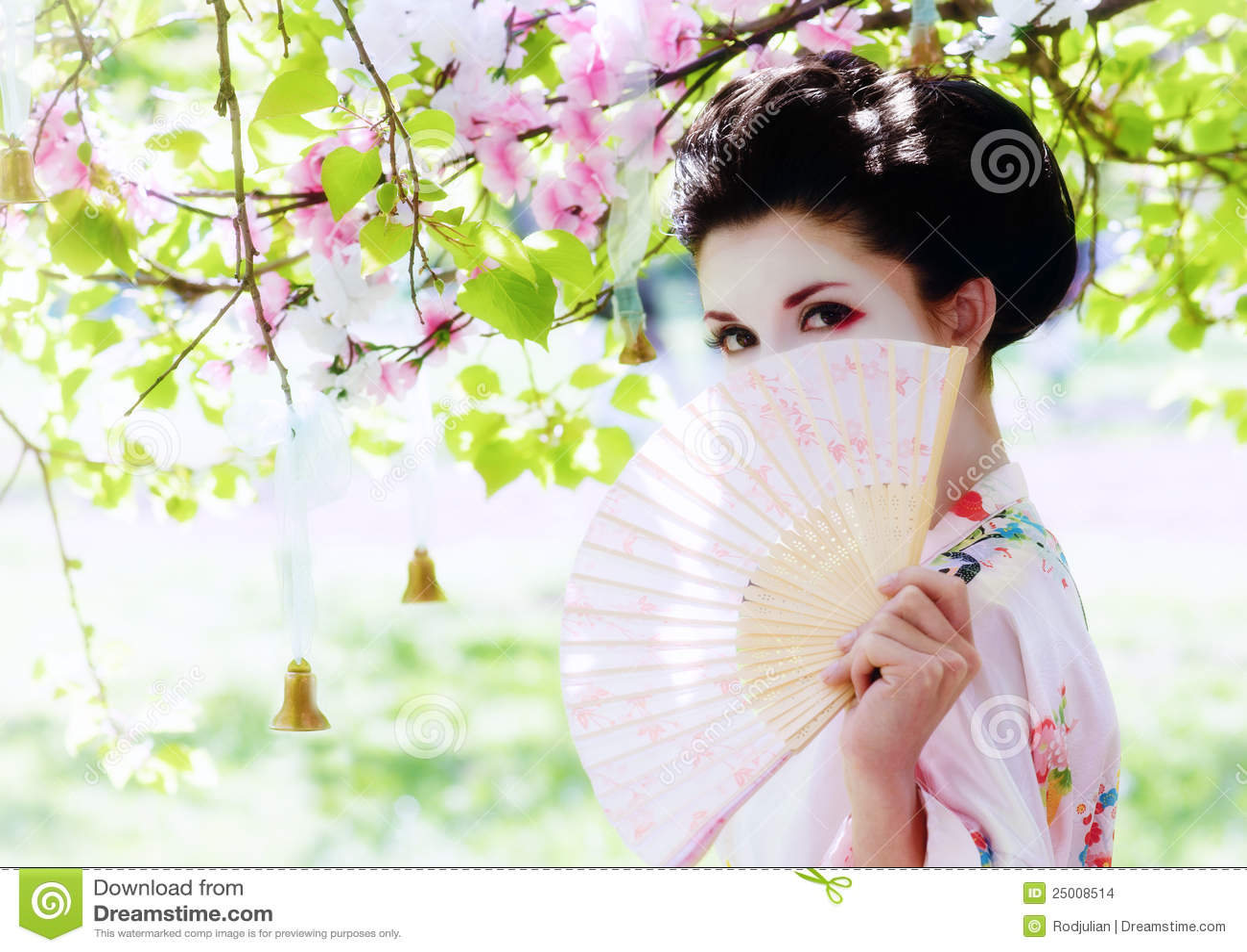 Geisha with fan in the garden