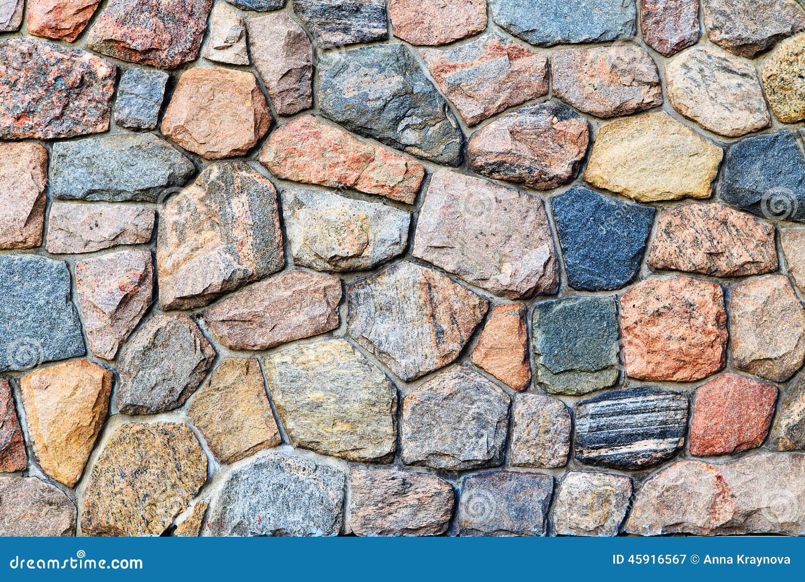 Gekleurde Stenen In Grijze Muur Stock Foto - Afbeelding: 45916567