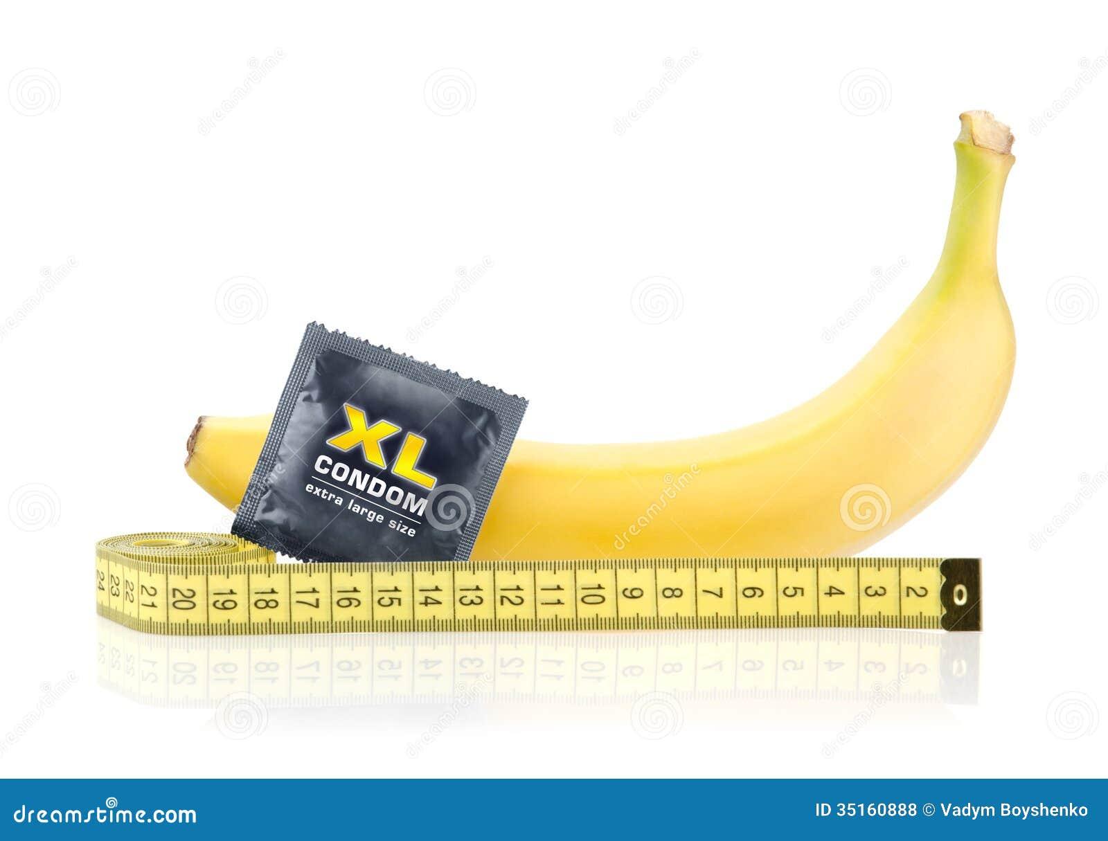 gelbe banane mit kondom und messendem band stockfoto bild von kondom instrument 35160888. Black Bedroom Furniture Sets. Home Design Ideas