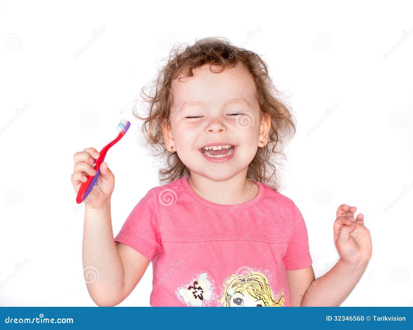 Gelukkig glimlachmeisje met tandenborstel