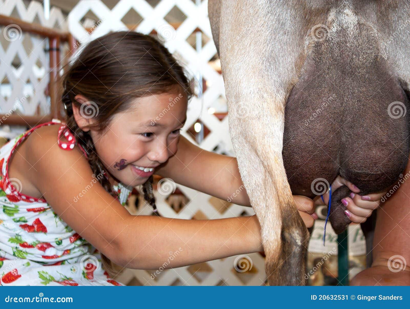 Gelukkig Jong Meisje dat aan het Melken van een Geit leert