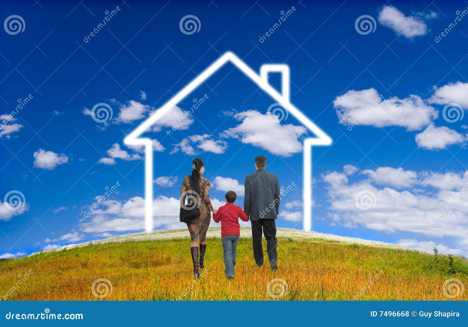 Gelukkige familie met huis