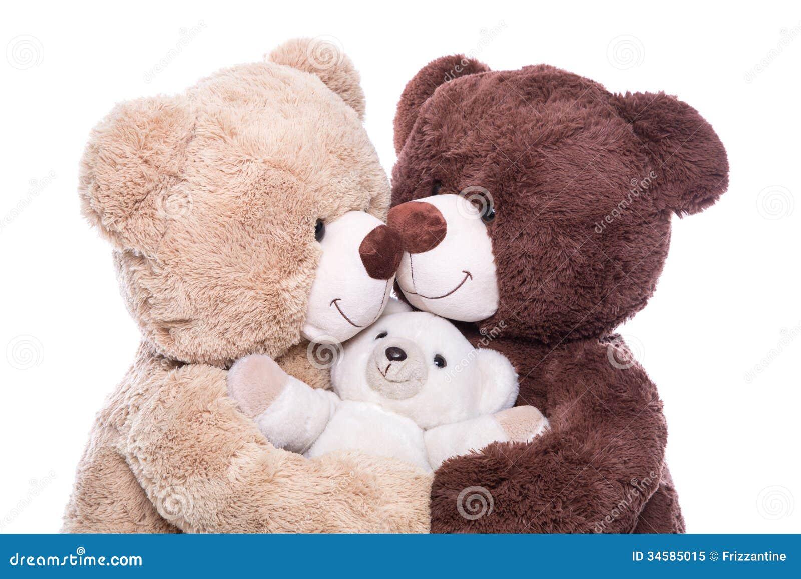 Gelukkige familie - moeder, vader en baby - concept met teddybeer
