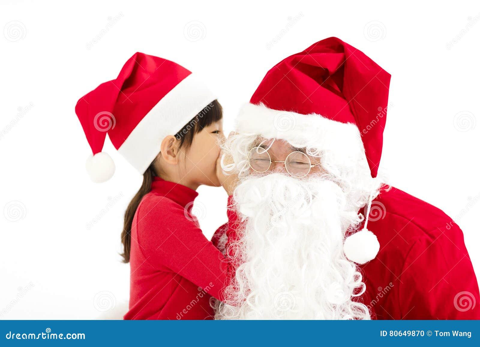 Gelukkige Meisje het vertellen wens in het oor van Santa Claus ` s