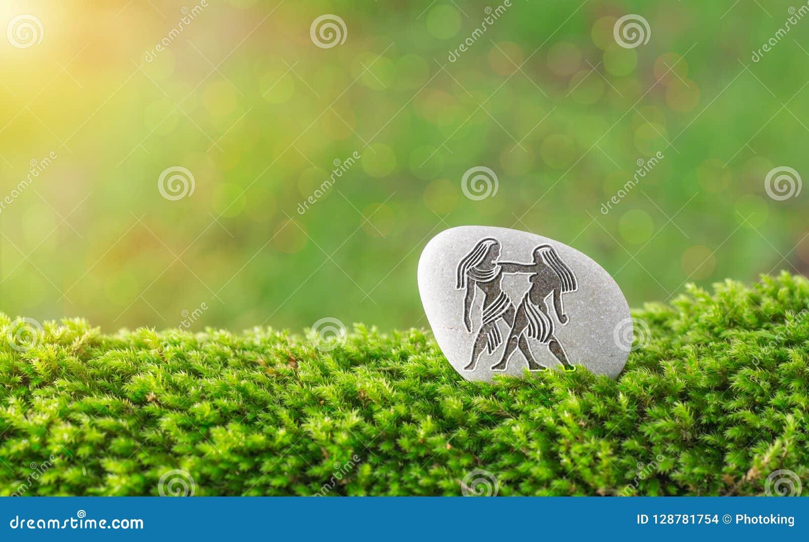 Gemini zodiac symbol in stone