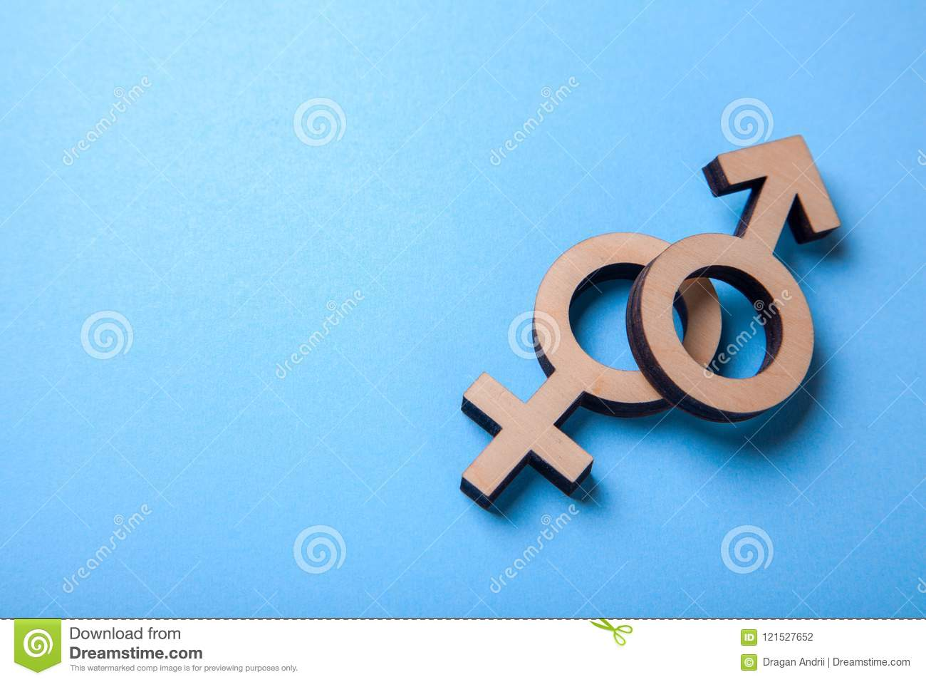 Gender Symbols Of Man And Woman Of Tree On Blue Copy Space For Text