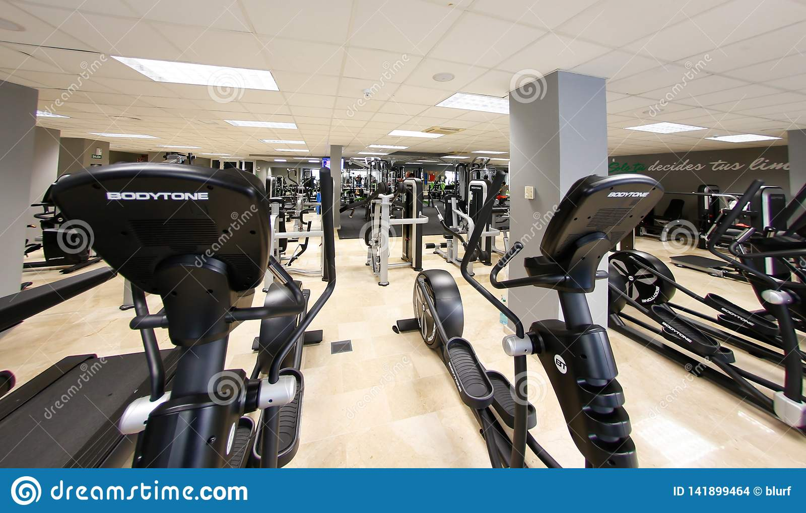 General view on running machines area on a gym detail editorial