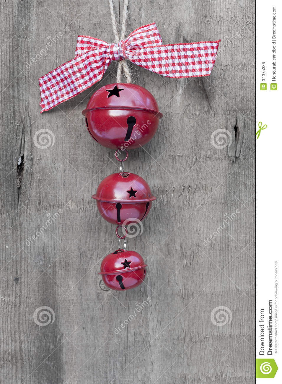 Generic machine made christmas bells ornament on rustic