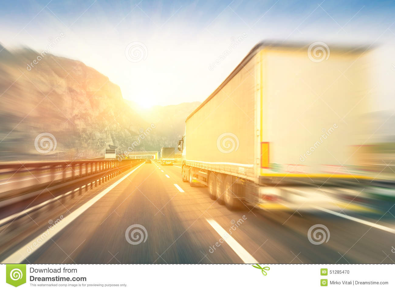 Download Generic Semi Trucks Speeding On The Highway At Sunset Stock Photo - Image of highway, logistic: 51285470