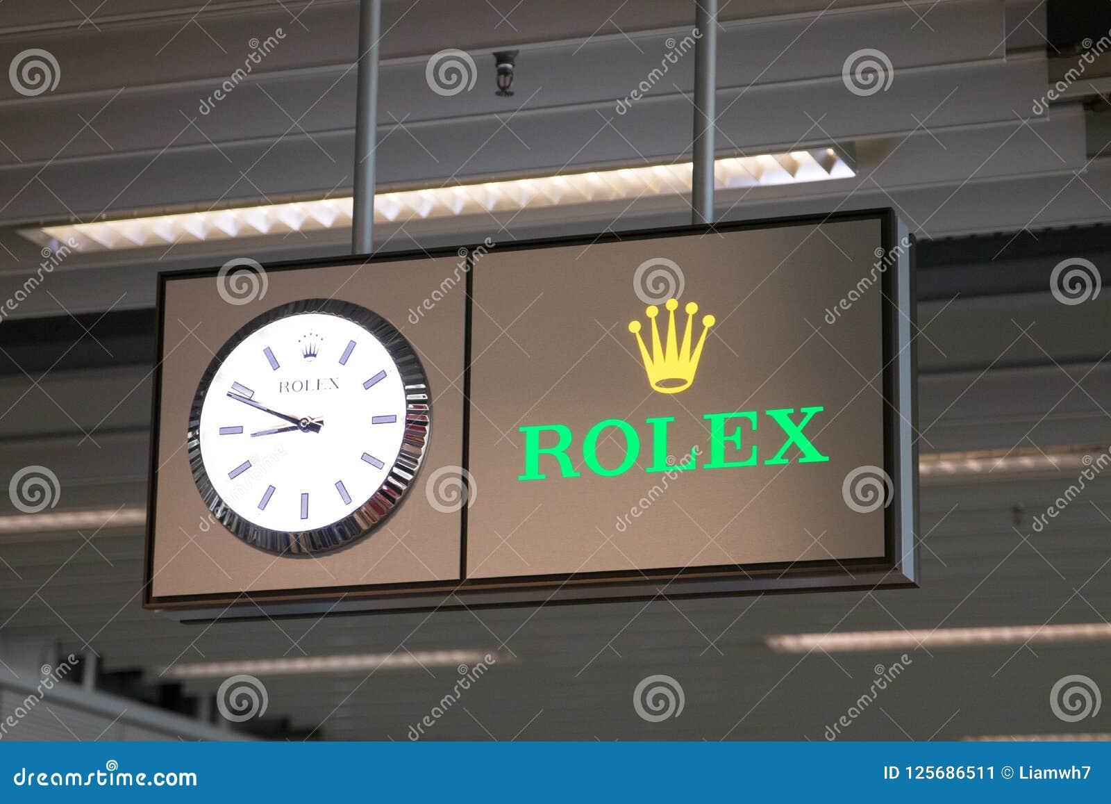 Genewa/switzerland-01 09 18: Rolex zegarowego zegarka logo w Geneva lotnisku