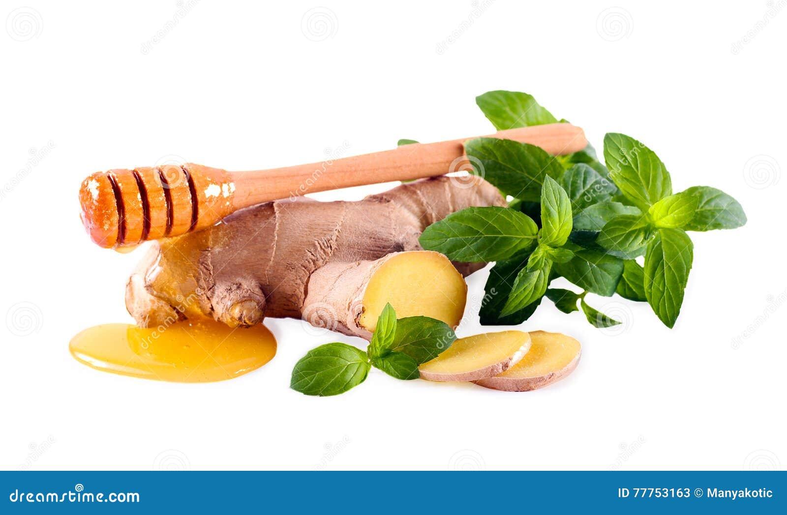 Gengibre, hortelã e mel sobre o fundo branco