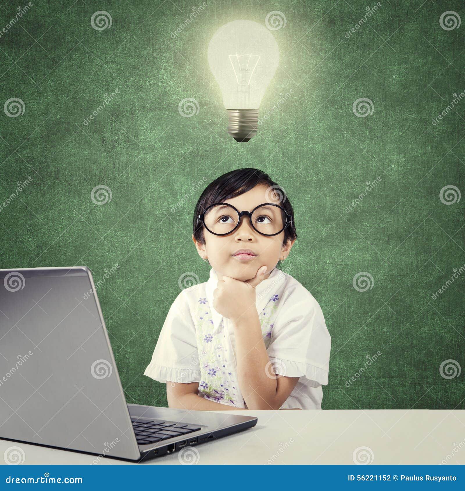 Genius Child With Laptop Thinks Idea Under Lamp Stock