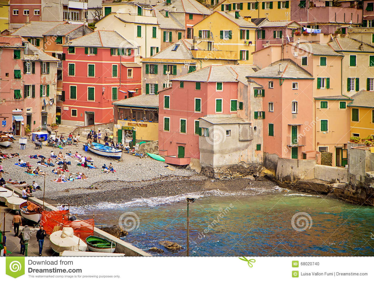 Genoa, Italy - bathers on the small shore of the Boccadasse bay