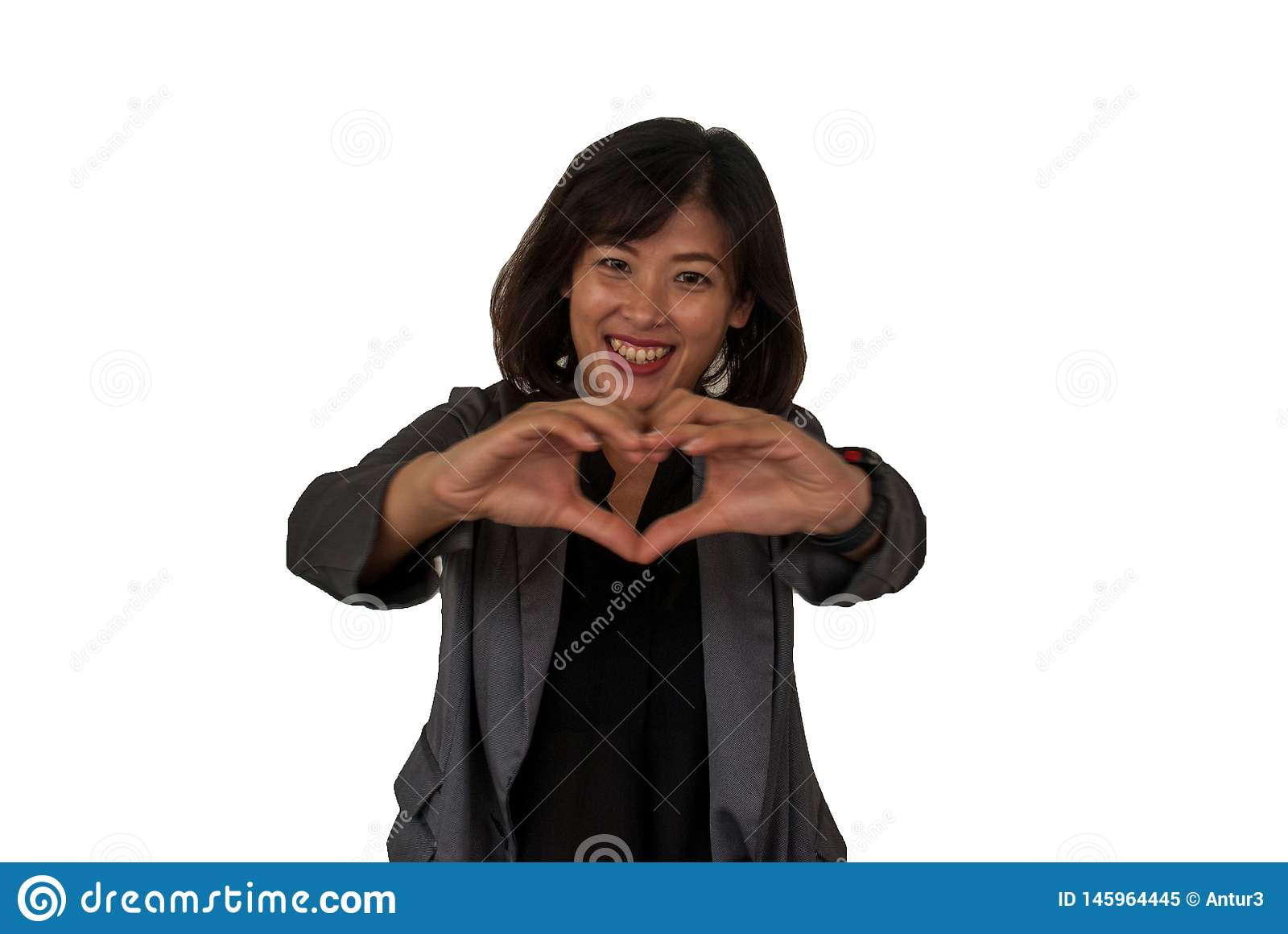 The genre of female businessmen creates hearts with his hands