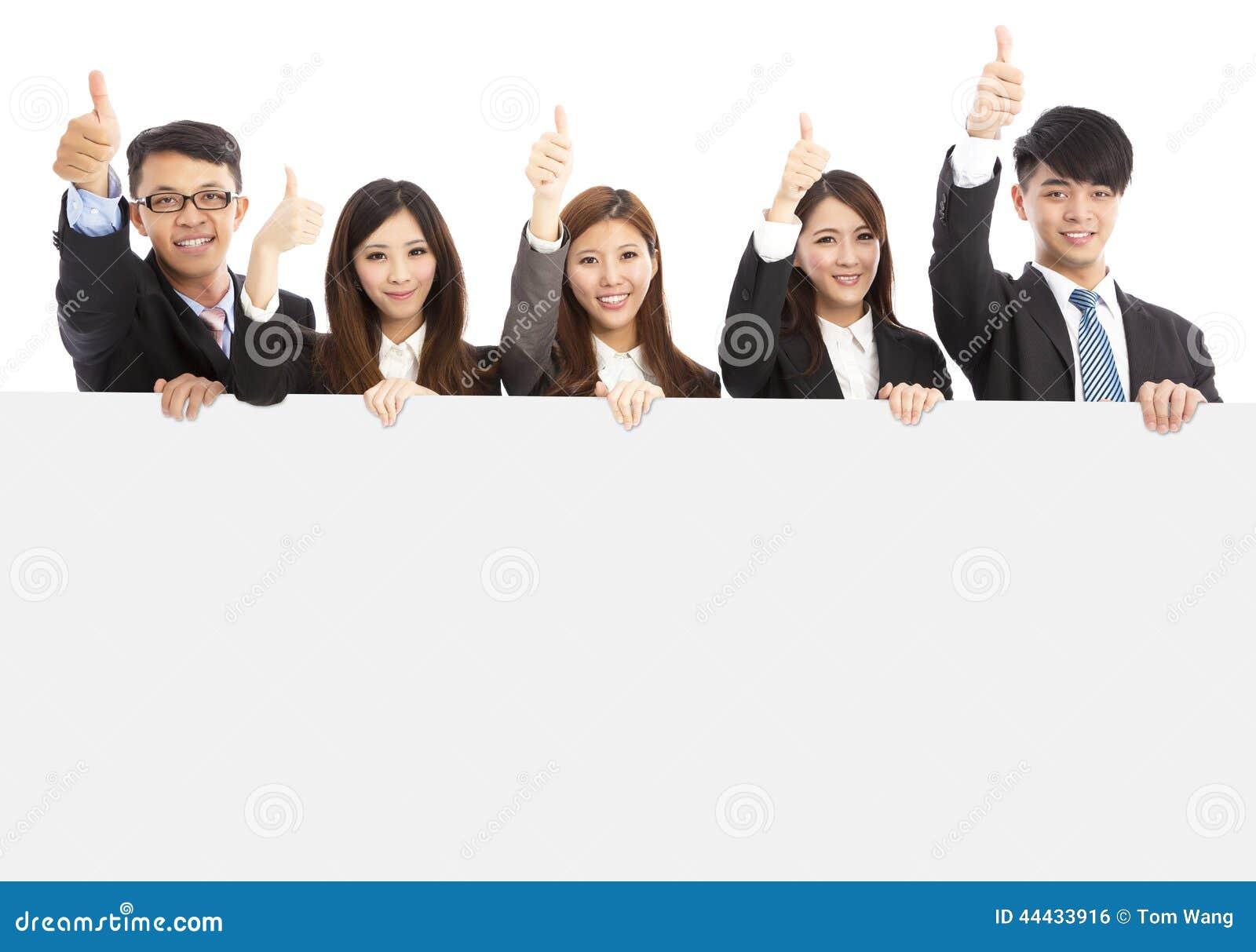 Gens d affaires asiatiques tenant le conseil blanc et le pouce