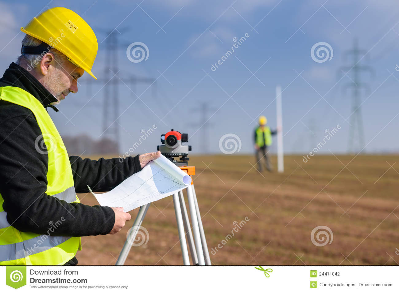 Geodesist measure land on construction site stock for How to read construction site plans