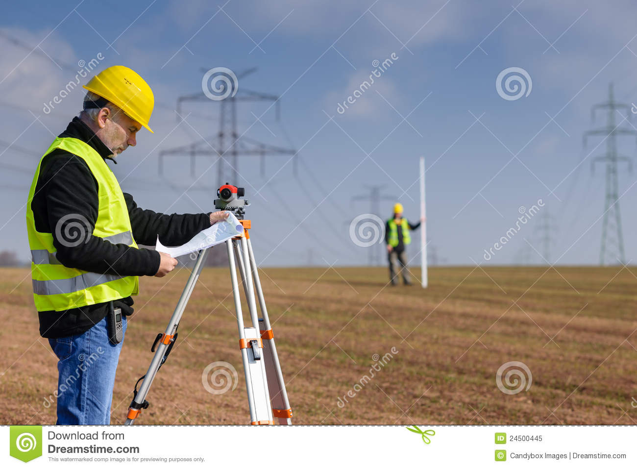 Geodesist measure land on construction site royalty free for How to read construction site plans