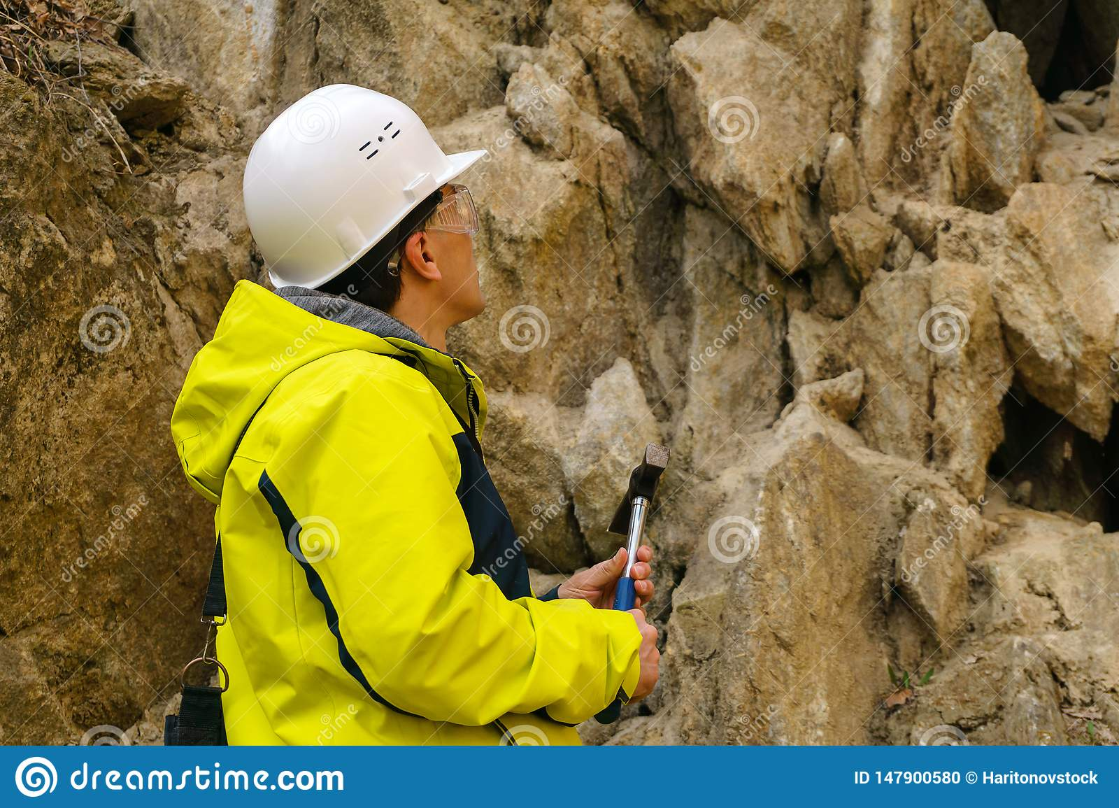 Geologist is going to take a rock sample