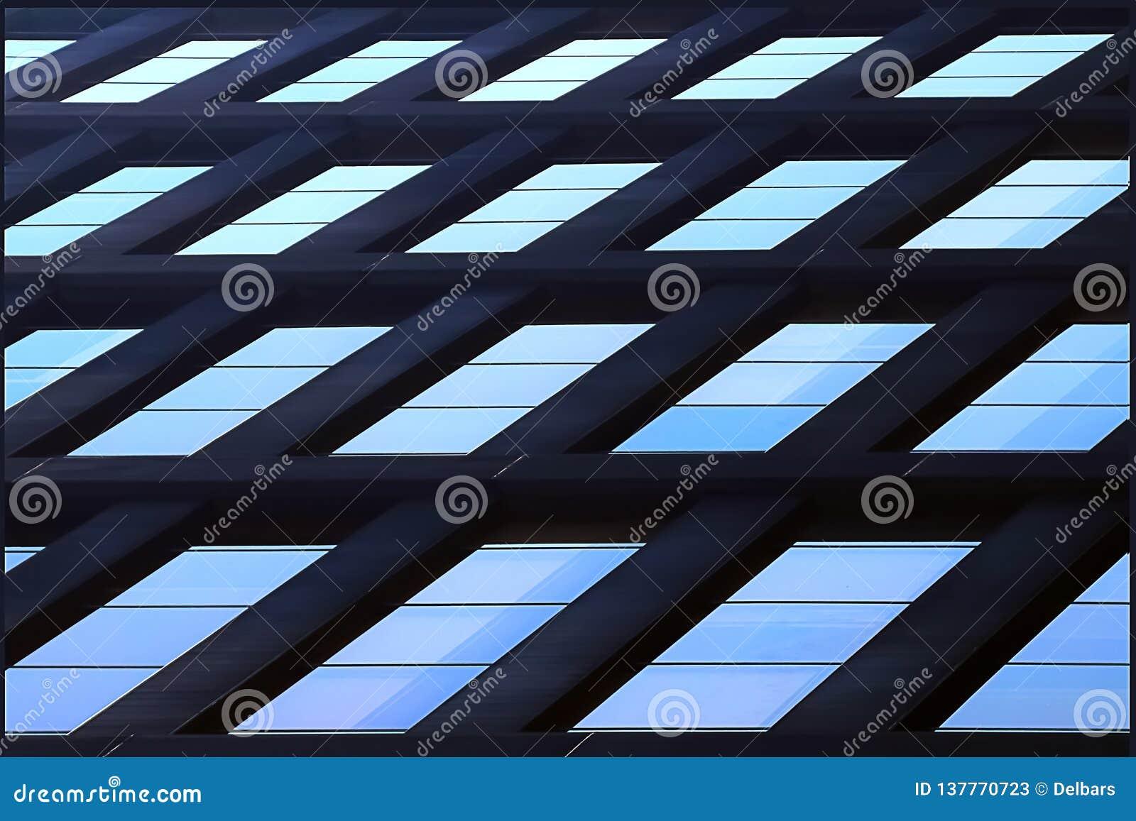 Geometric architectural background of blue. Skyscraper glass windows.