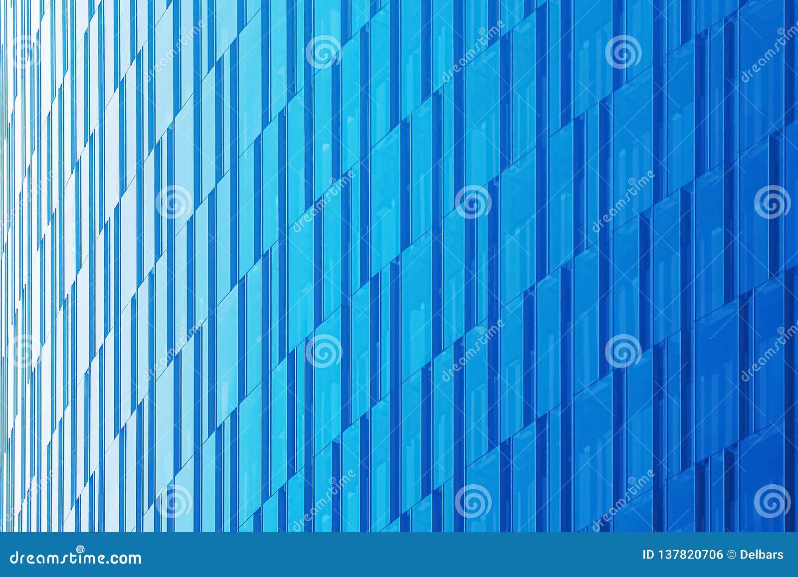 Geometric architectural urban background in blue tones. The glass facade of a skyscraper.