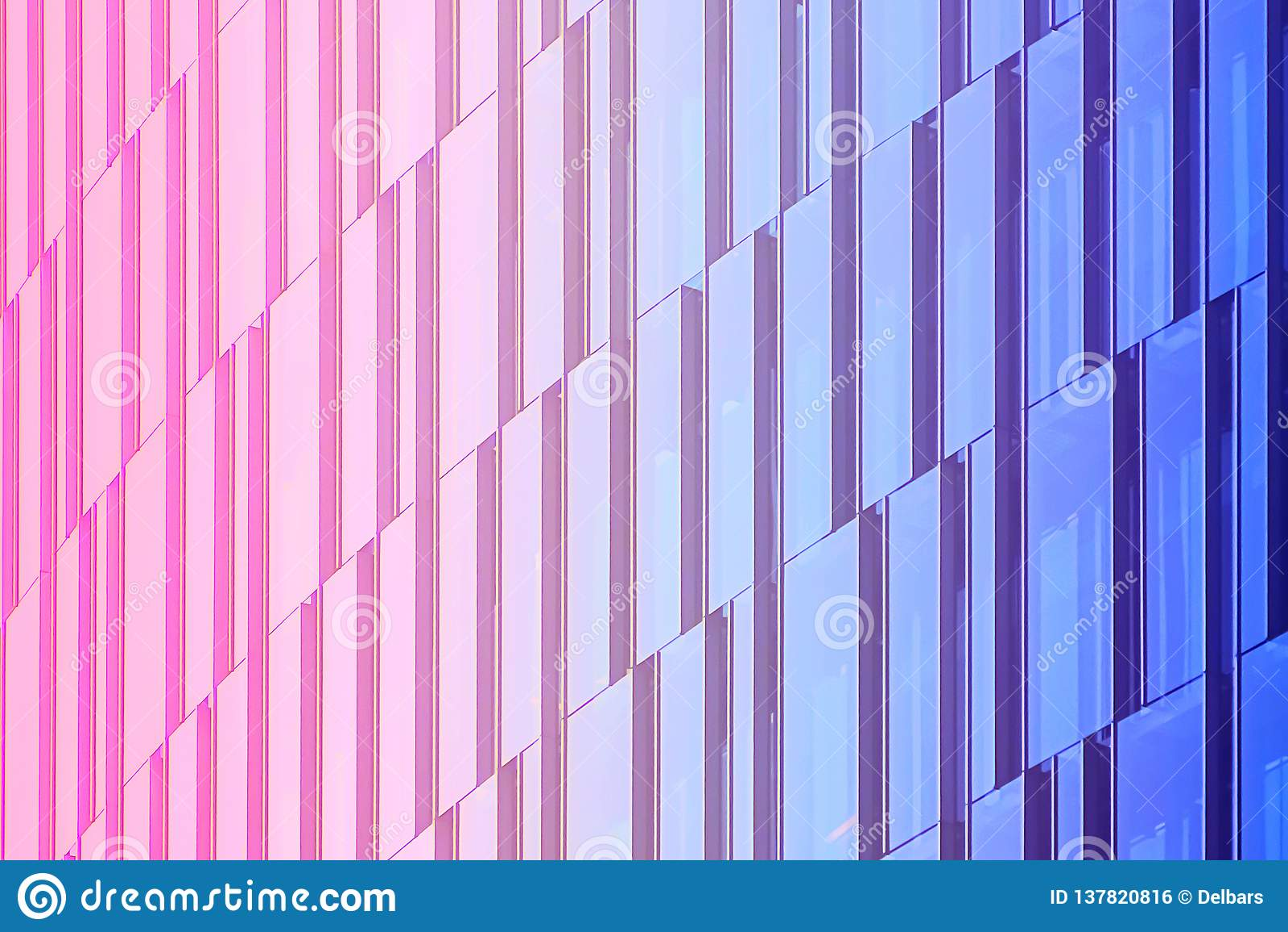 Geometric architectural urban background. The glass facade of a skyscraper.