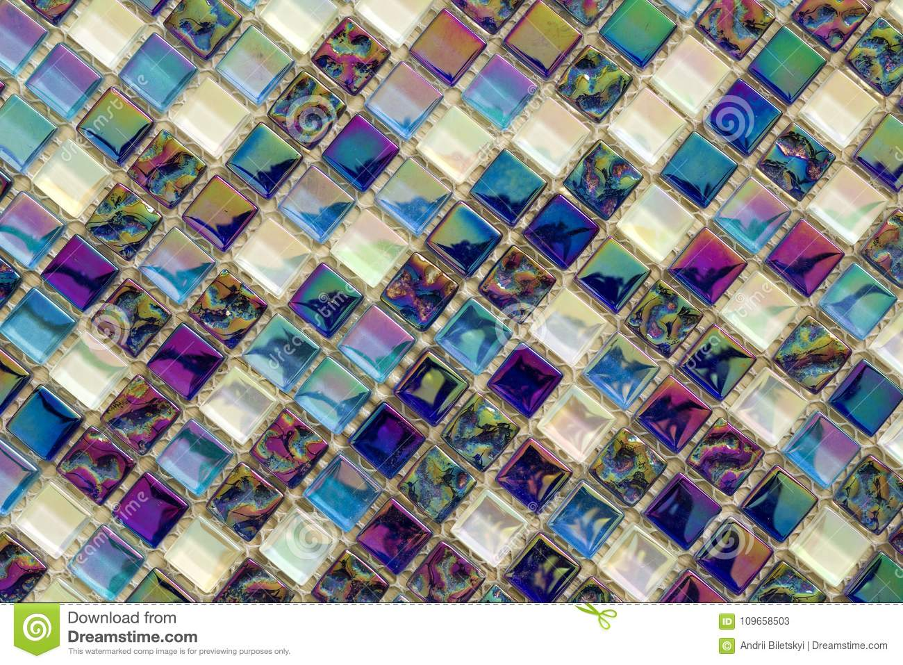 Geometric blue, purple and green mosaic tiles pattern. Wallpaper texture background. Small pieces tiles for construction and renov