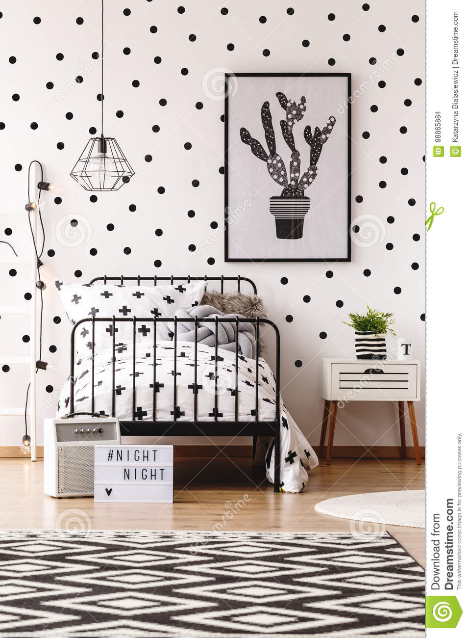 monochromatic kids room with carpet stock photo image of childgeometric carpet and simple poster in monochromatic kids room with white wallpaper with black dots