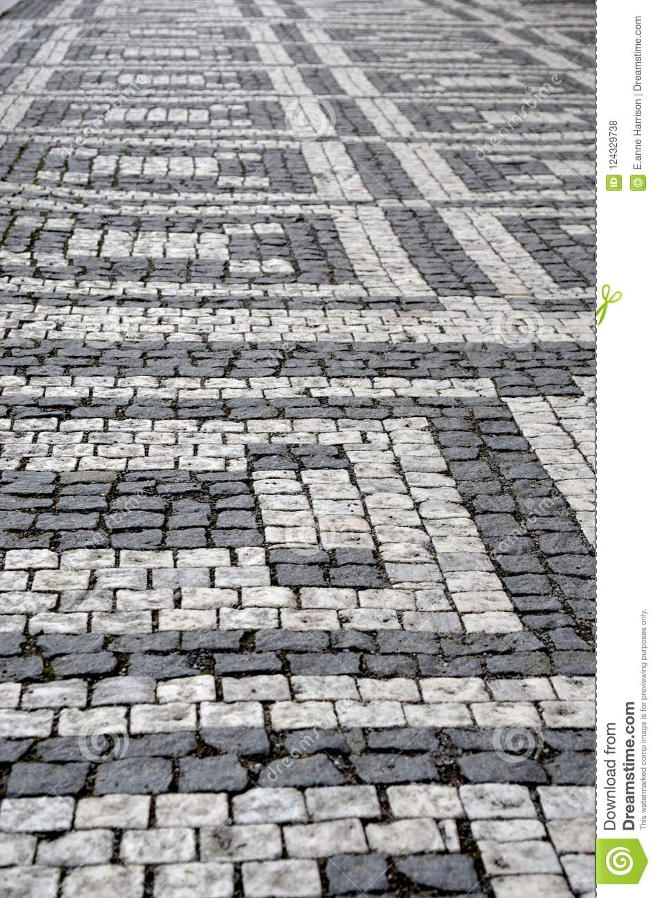 A Geometric Pattern Made By Light And Dark Grey Cobblestones Stock