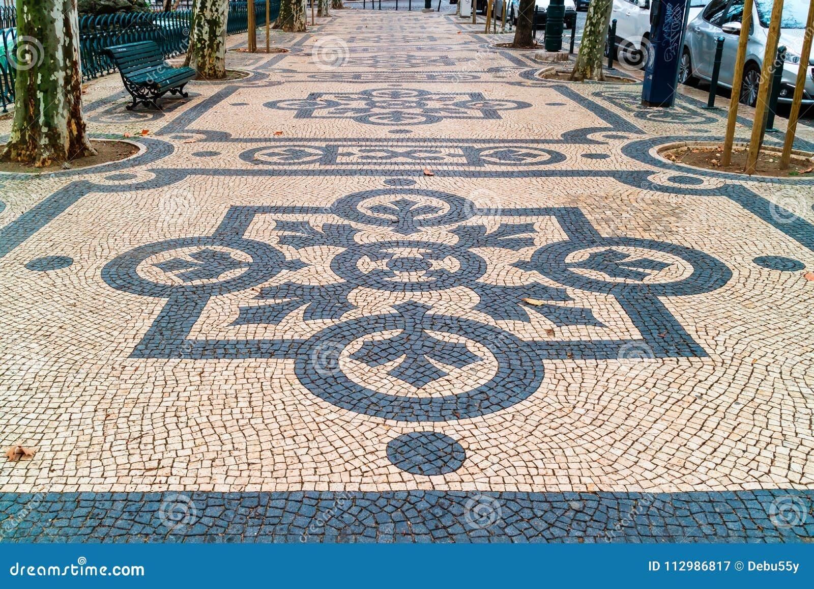 Geometric patterns of public walkways in Lisbon.