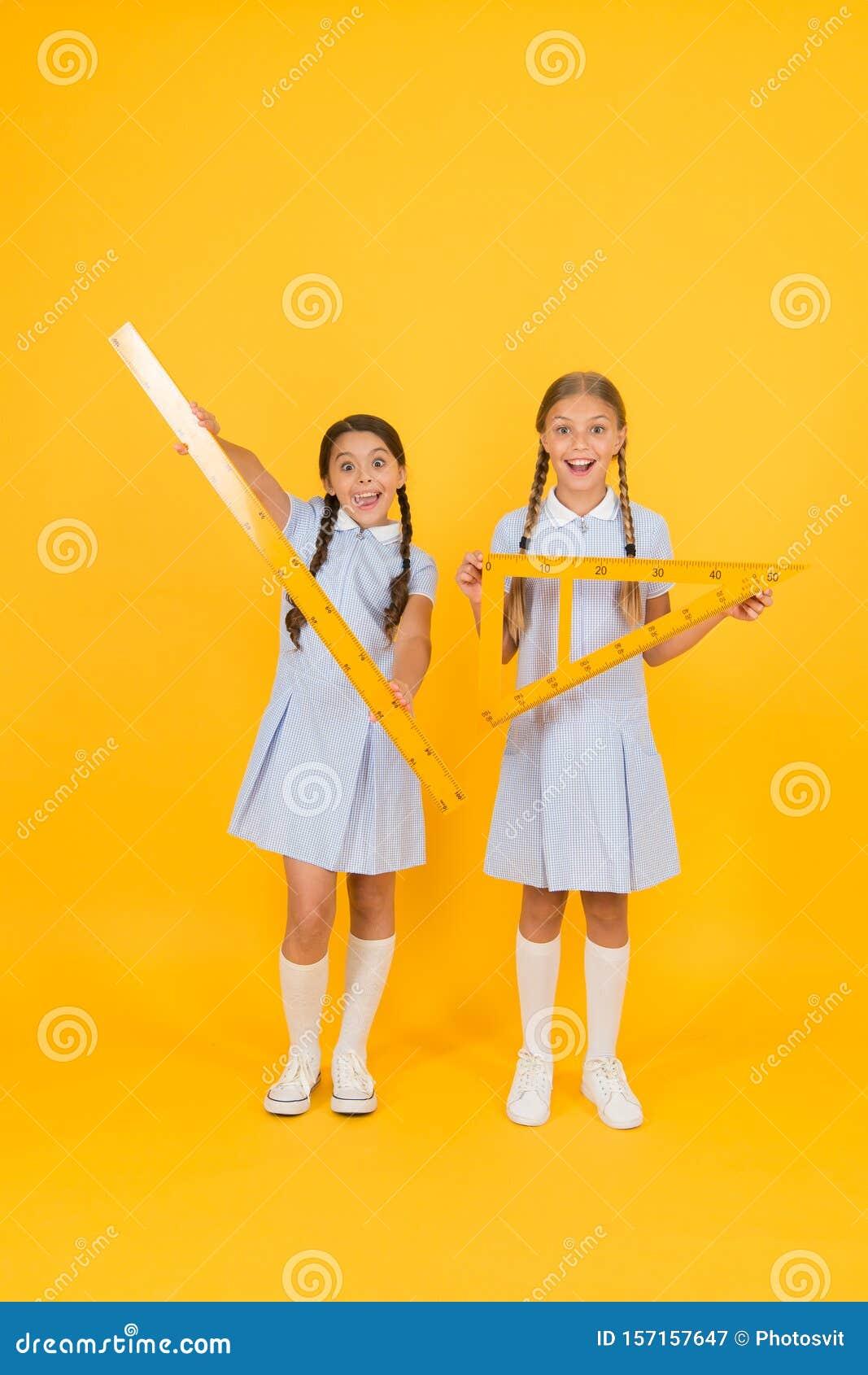 Geometric shapes. small girls love geometry. old school. modern education. happy friends in retro uniform. vintage kid