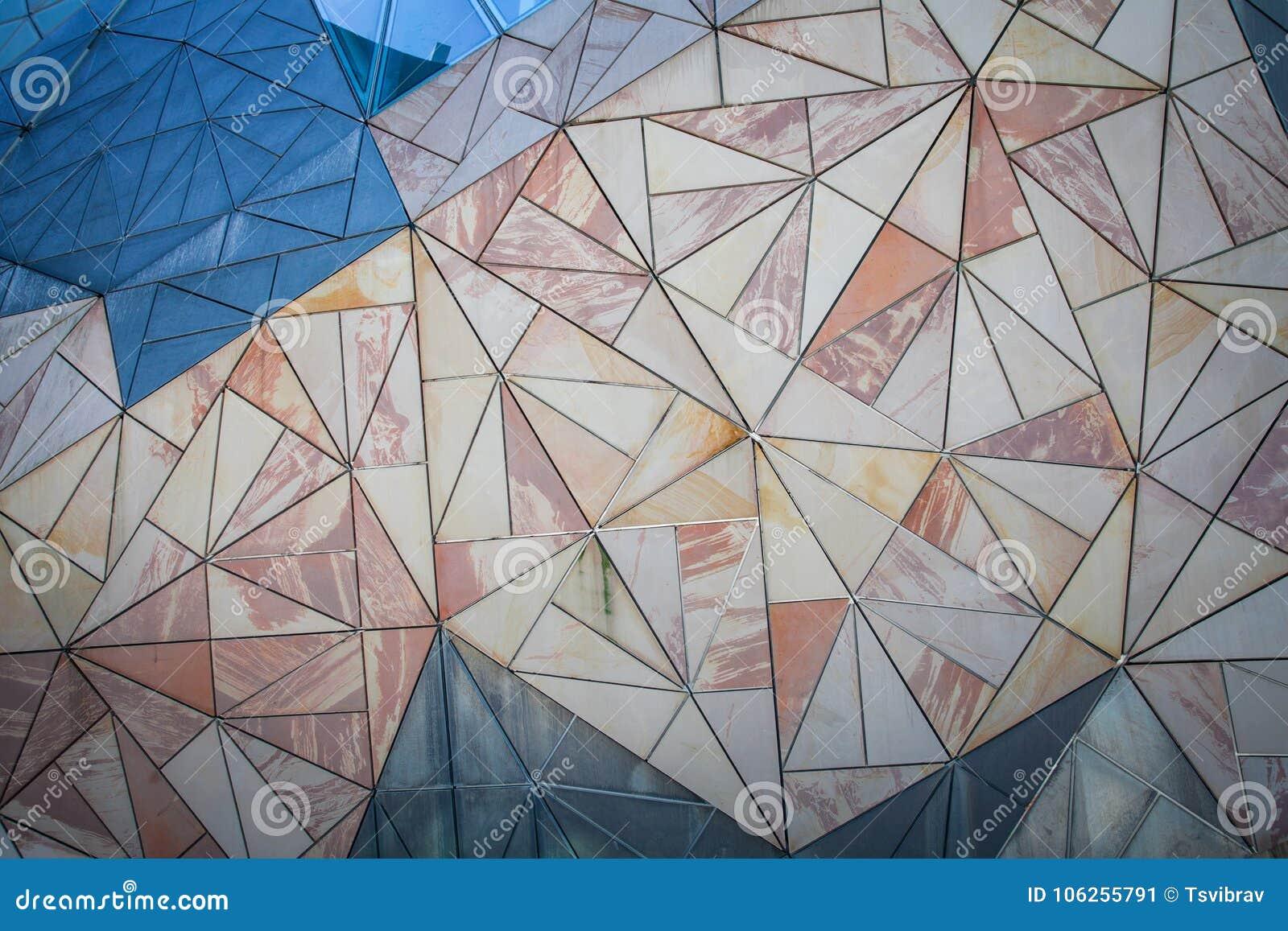 Geometric triangle pattern background on wall.