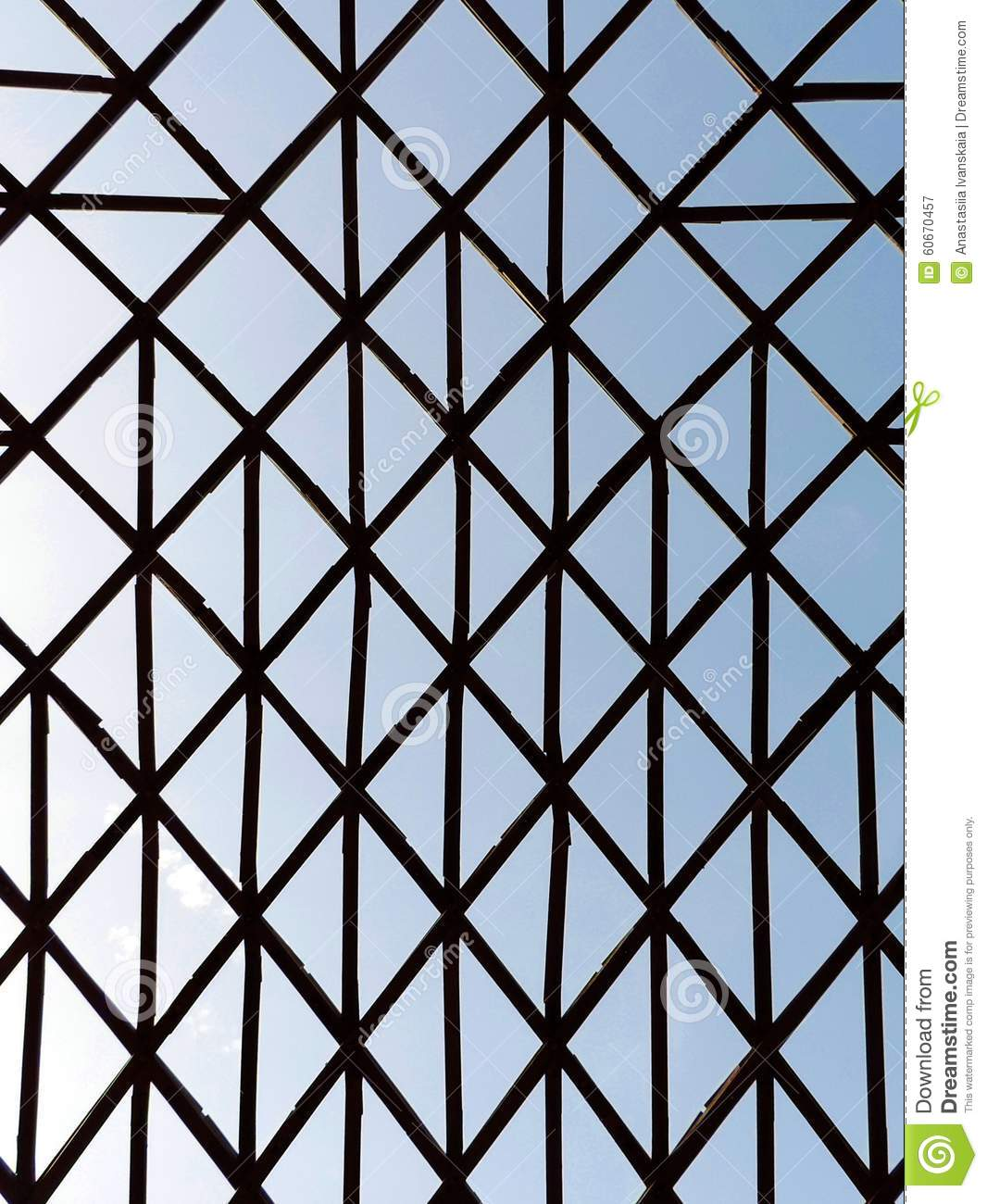 Geometric unusual structure with crossed wooden bars.