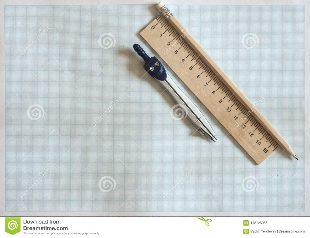 pencil, compass and rulers on graph paper background stock image