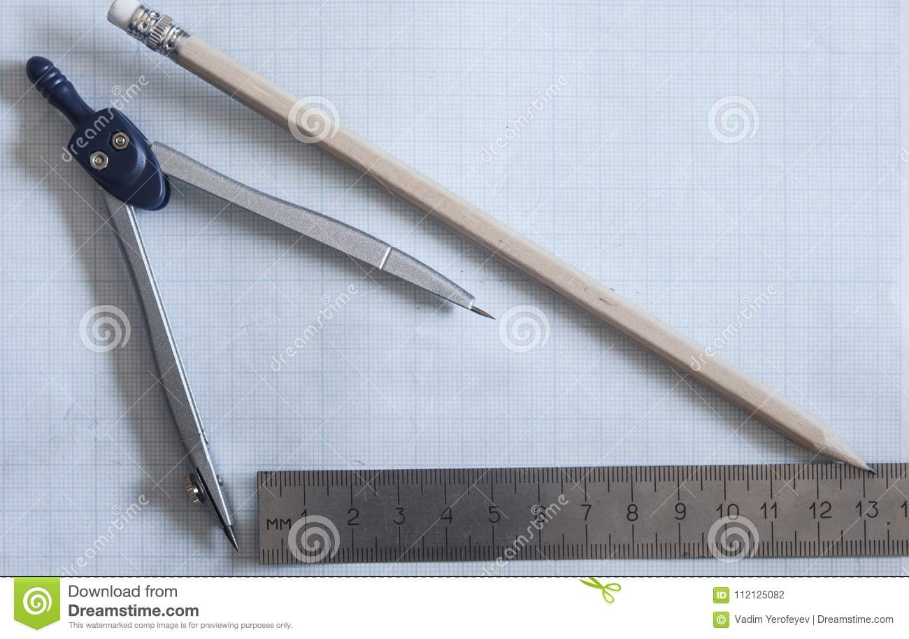 pencil, compass and rulers on graph paper background stock photo