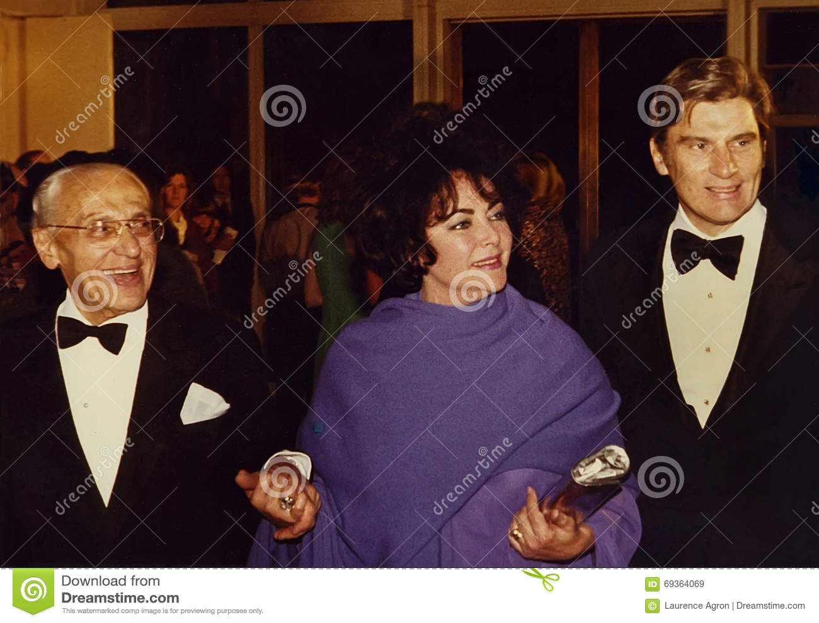 George Cukor, Elizabeth Taylor, and John Warner