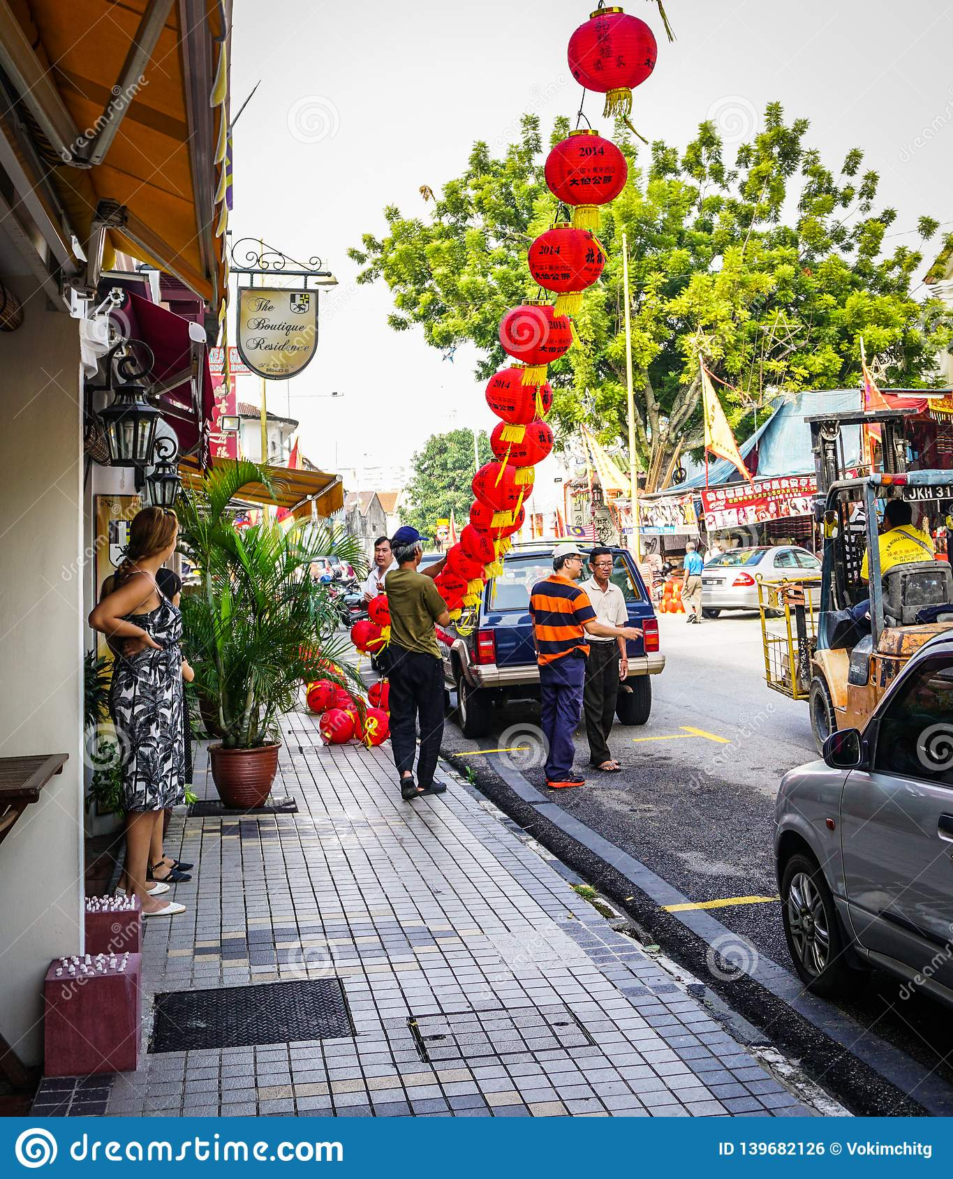 Red Chinese lanterns hanging in a street