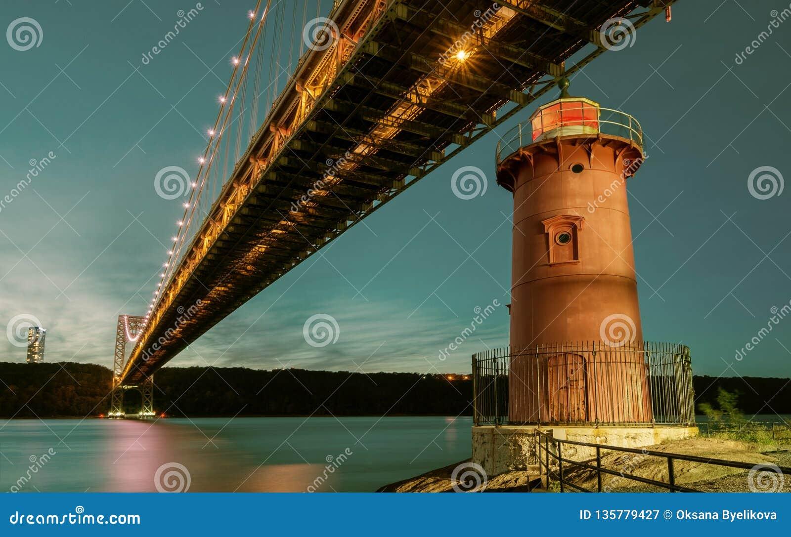George Washington Bridge and Red Little Lighthouse officially Jeffrey`s Hook Light, New York, USA