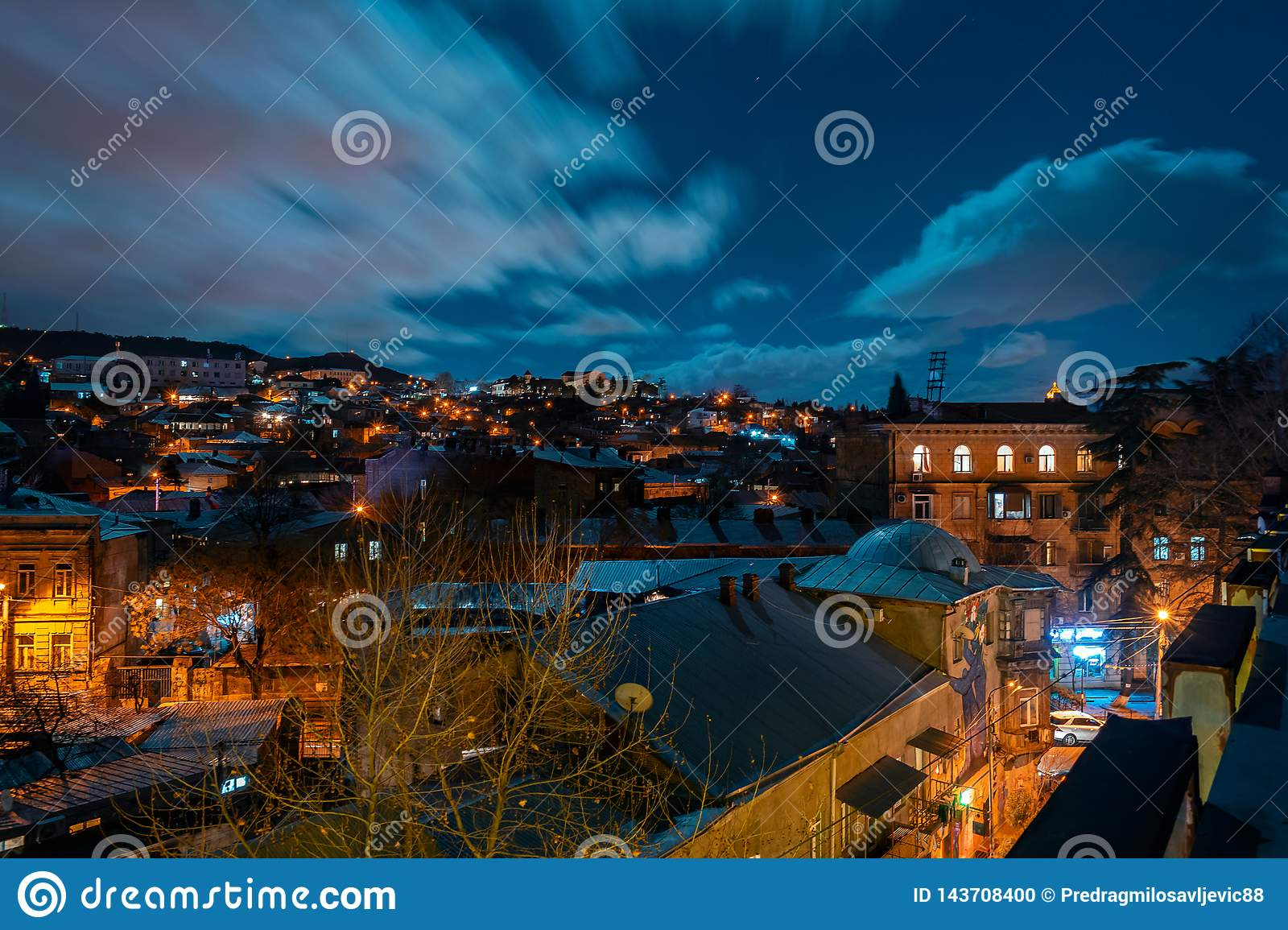 Georgia, Tbilisi - 05.02.2019. - Night cityscape view. Thick clouds moving over the sky- Image