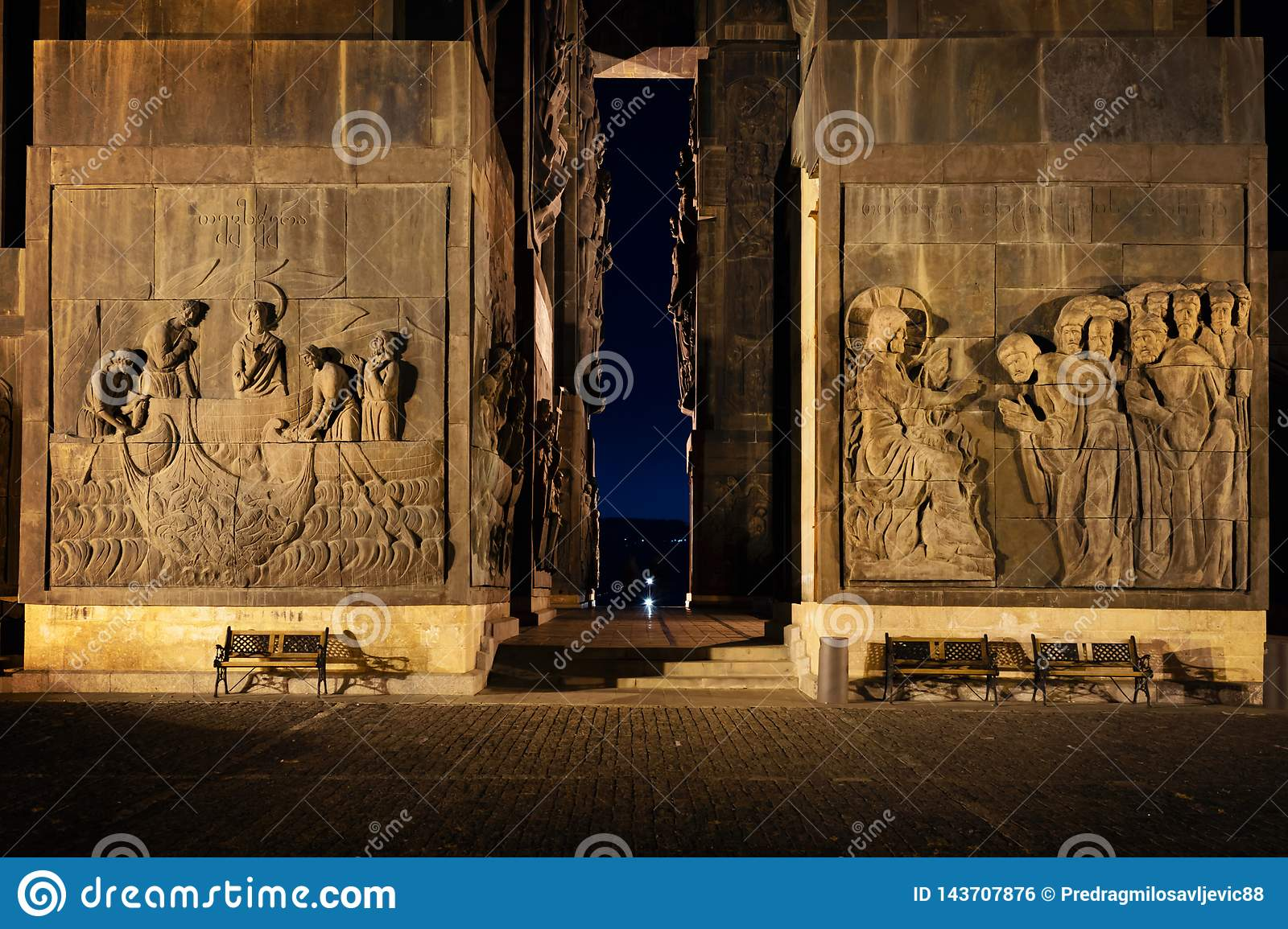 Georgia, Tbilisi - 05.02.2019. - Relief carvings on the walls of massive monumental structure Chronicles of Georgia - Night image