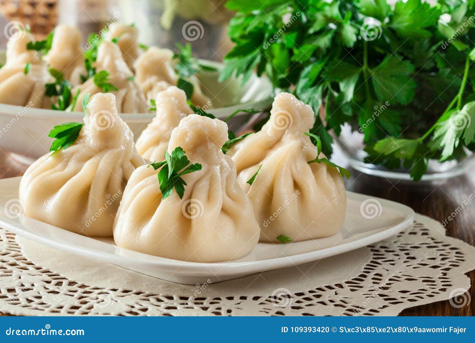 Georgian dumplings - Khinkali Chinkali with minced meat and herbs