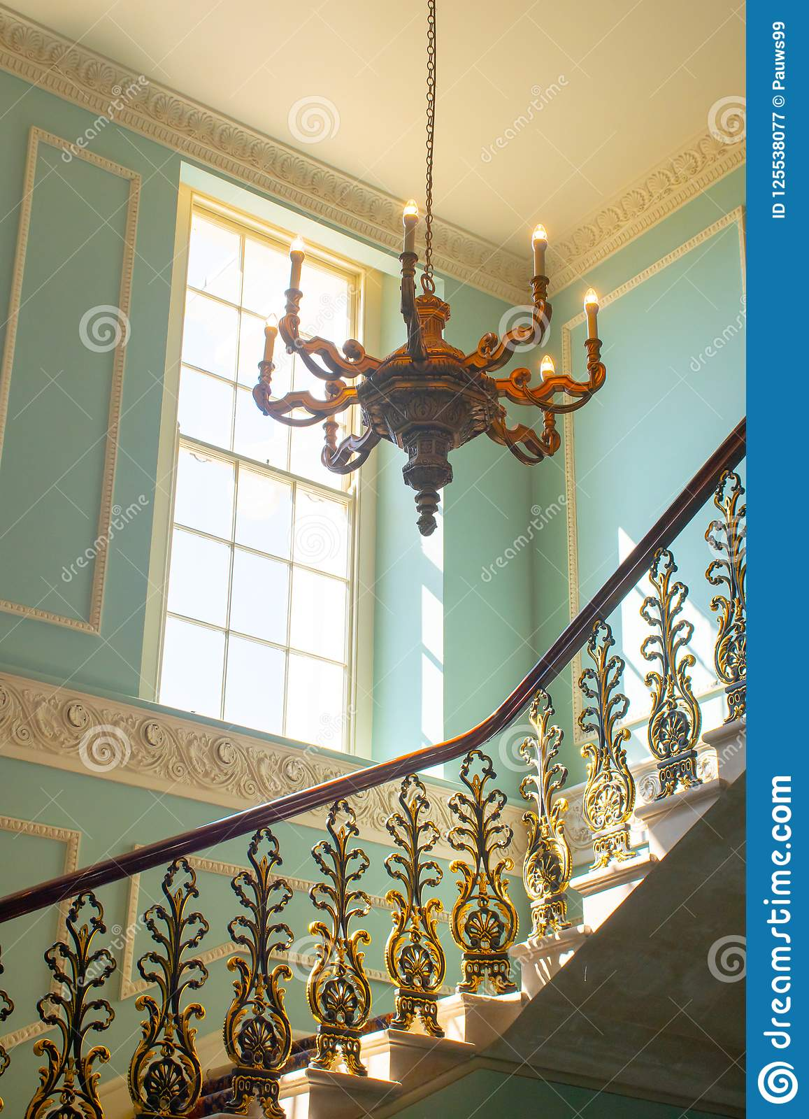 Georgian Stairway With Chandelier Hanging From The Ceiling ...