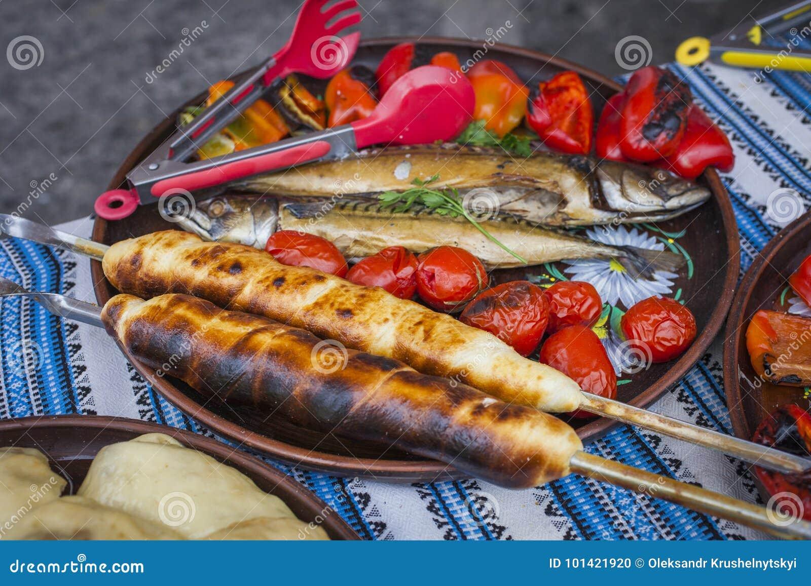 Georgian traditional dish - khachapuri, pastry with cheese tomatoes