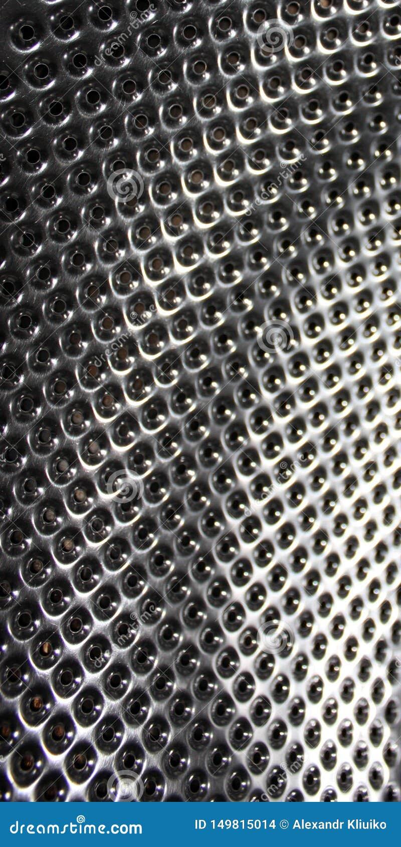 Geperforeerd roestvrij staal, textuur of metaalachtergrond