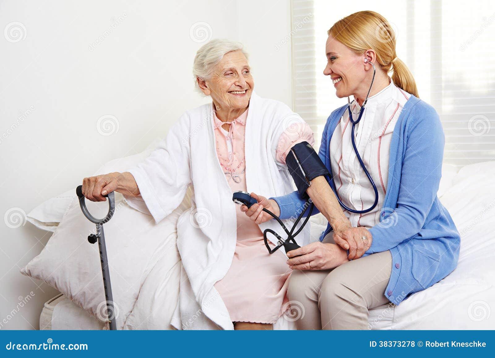 Geriatric Nurse Measuring Blood Royalty Free Stock Photos