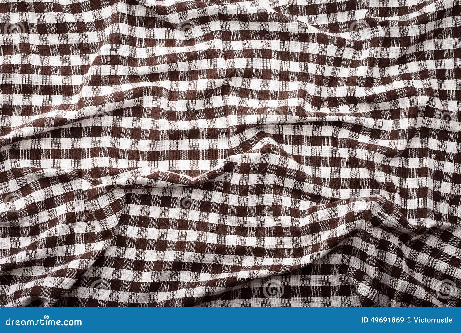 Gerimpeld tafelkleed braun geruit schots wollen stof in het behang van de kooitextuur stock - Behang van de jaren ...