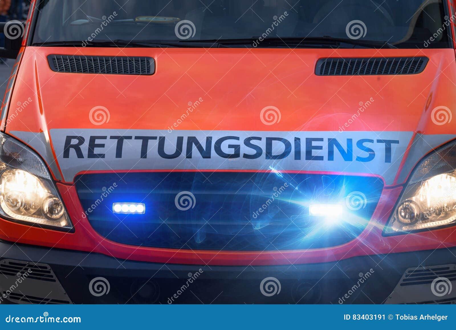 german ambulance car with flashing warning lights stock image