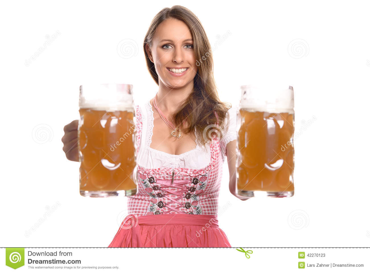 German or Bavarian waitress with her hair in pigtails wearing a ...