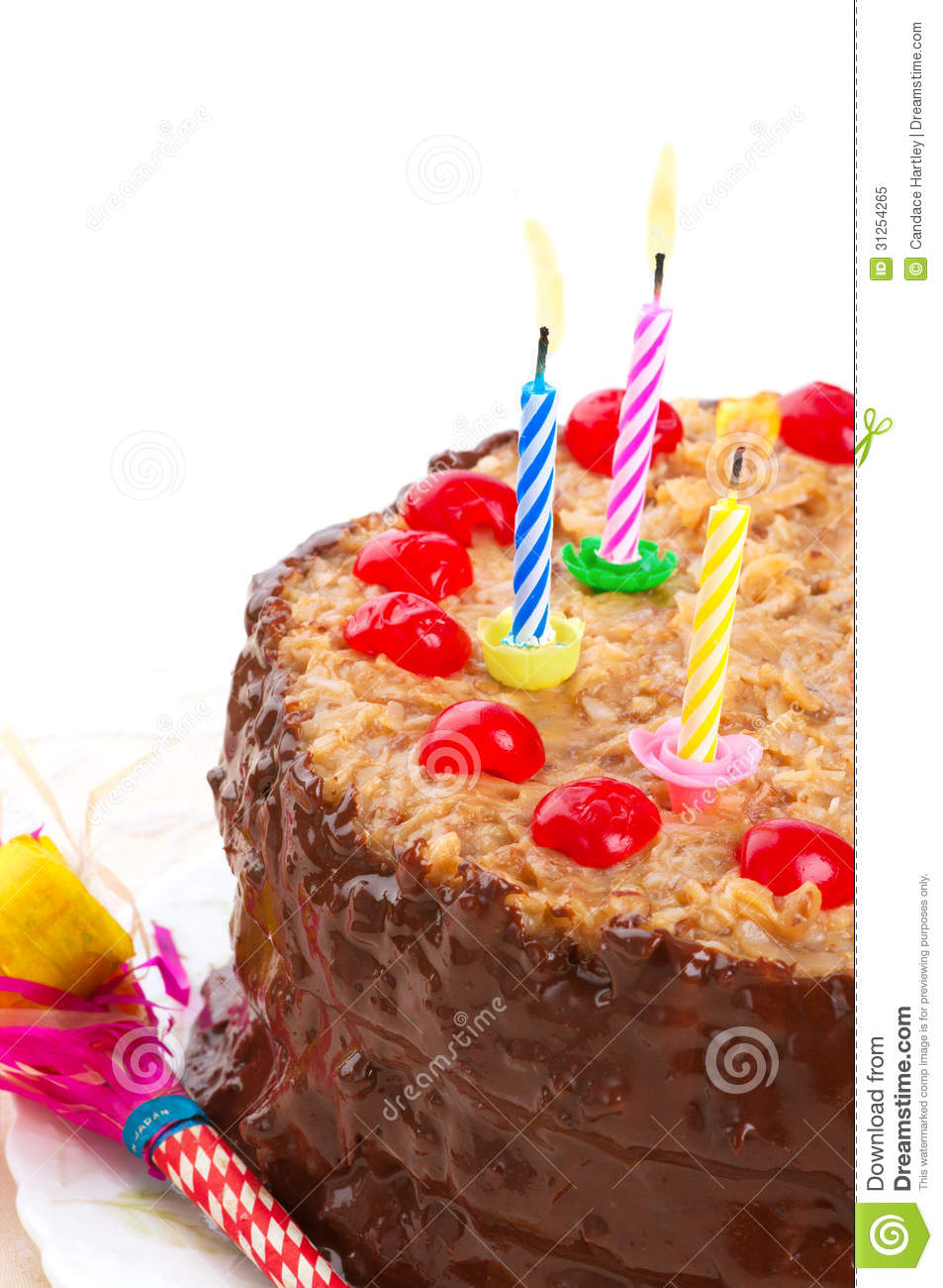 German Chocolate Birthday Cake With Lighted Candles Stock