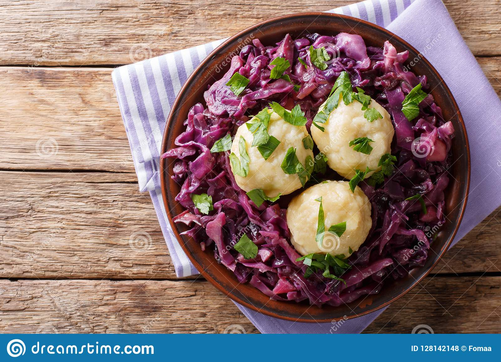 German food knodel potato dumplings and stewed red cabbage close