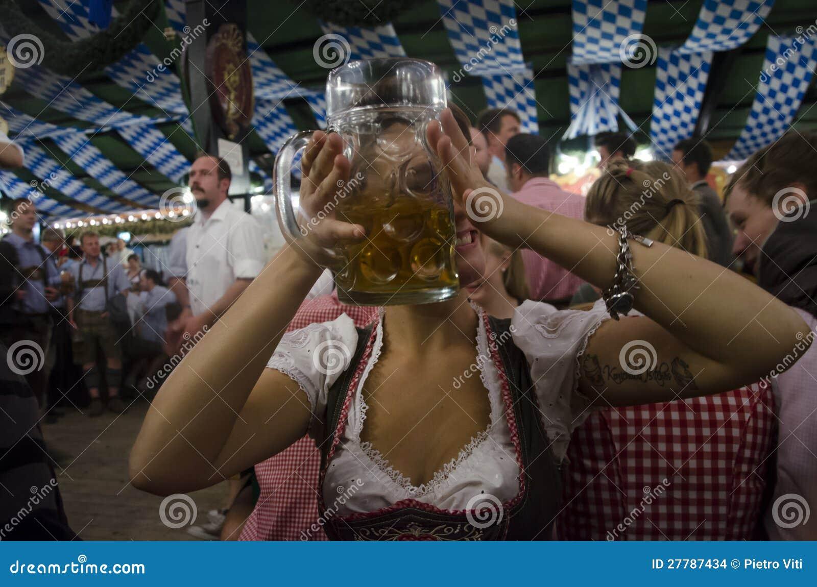 German girl drinking during Oktoberfest 2012